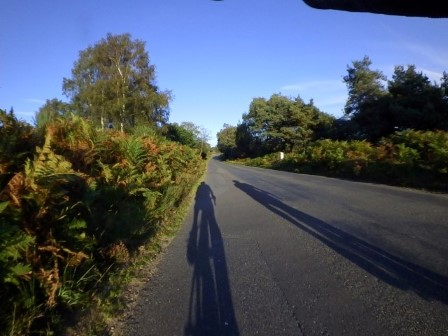 Riding along Braggers Lane near Bransgore with Philip Grant as the sun casts our shadows before us